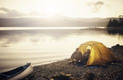 Shot of a couple camping on a remote inlet in Tasmania